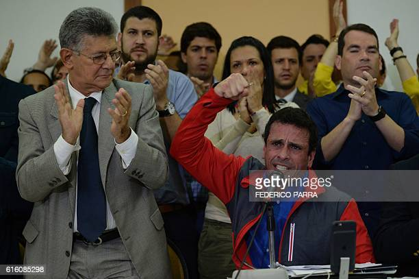 TOPSHOT Venezuelan opposition leader Henrique Capriles speaks next to the president of the National Assembly Henry Ramos Allup during a press...