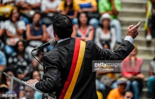 Venezuelan opposition leader Henrique Capriles speaks to supporters during a rally in Caracas on October 11 2017 Venezuelans will go to gubernatorial...