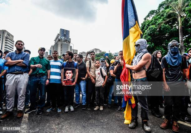 TOPSHOT Venezuelan opposition leader Henrique Capriles takes part in a march paying tribute to student Juan Pablo Pernalete killed on the eve by...