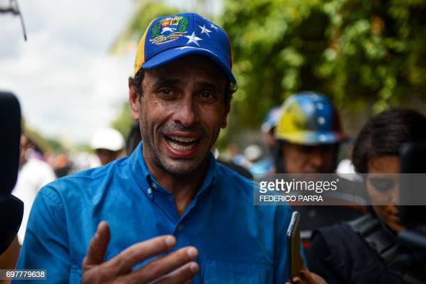 Venezuelan opposition leader Henrique Capriles takes part in a protest against the government of President Nicolas Maduro along the Francisco Fajardo...