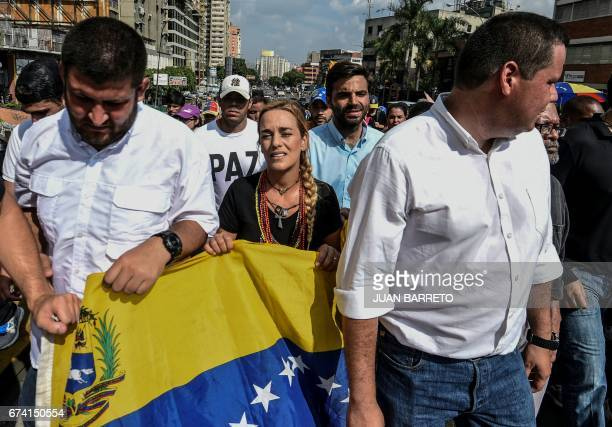 Venezuelan opposition leader Lilian Tintori wife of jailed opposition leader Leopoldo Lopez takes part in a march paying tribute to student Juan...