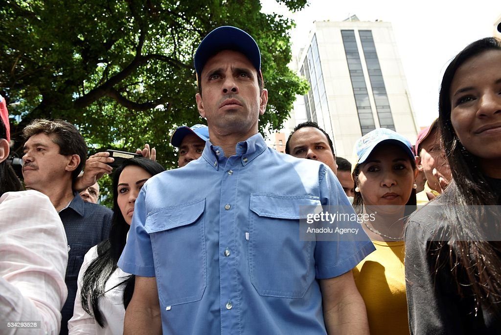 Venezuelan opposition leader, Miranda state Governor Henrique Capriles, arrives for an anti-government demonstration outside the Supreme Tribunal of Justice (TSJ) in Caracas, Venezuela on May 25, 2016. Protesters seeking to drive Venezuela's President Nicolas Maduro from office launched fresh street rallies.