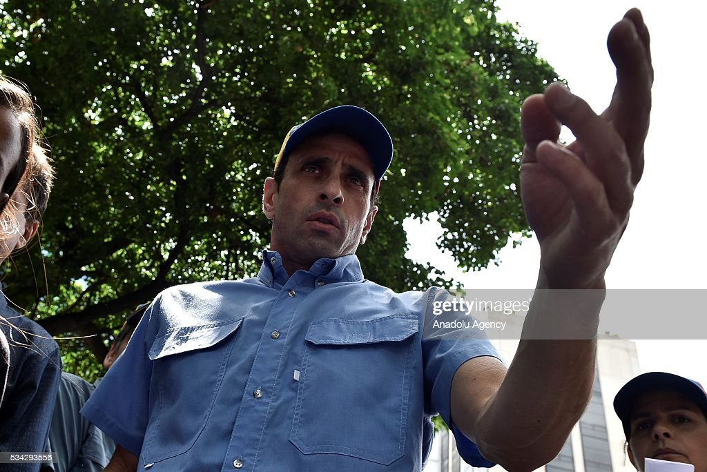 Venezuelan opposition leader, Miranda state Governor Henrique Capriles, speaks to the media during an anti-government demonstration outside the Supreme Tribunal of Justice (TSJ) in Caracas, Venezuela on May 25, 2016. Protesters seeking to drive Venezuela's President Nicolas Maduro from office launched fresh street rallies.