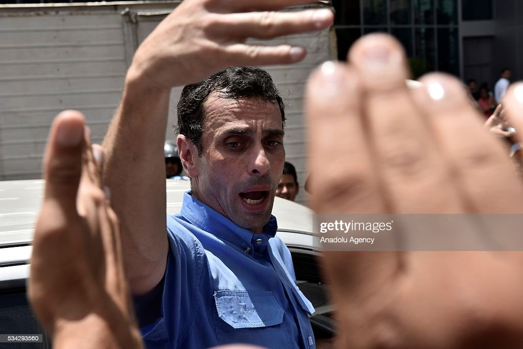 Venezuelan opposition leader, Miranda state Governor Henrique Capriles, participates in an anti-government demonstration outside the Spreme Tribunal of Justice (TSJ) in Caracas, Venezuela on May 25, 2016. Protesters seeking to drive Venezuela's President Nicolas Maduro from office launched fresh street rallies.