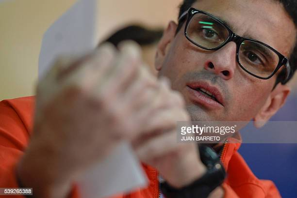 Venezuelan opposition leader Miranda state Governor Henrique Capriles speaks during a press conference in Caracas on June 10 2016 Venezuelan...