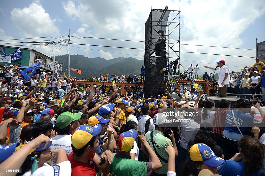 Venezuelan opposition presidential candidate Henrique Capriles (R) delivers a speech during a rally in Valera, Trujillo state, Venezuela on March 26, 2013. Venezuela will elect its new president on April 14, 2013. AFP PHOTO