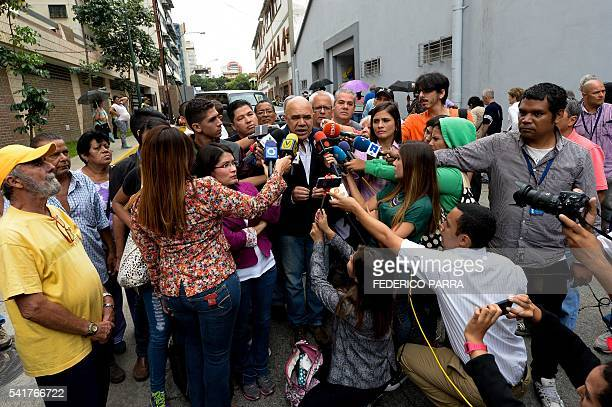 Venezuelan opposition spokesman of the Democratic Unity Roundtable Jesus Torrealba speaks with the press during the authentication before the...