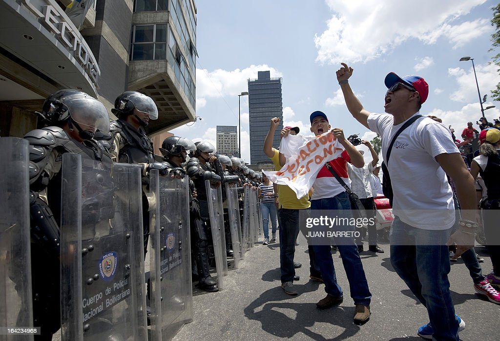 Venezuelan opposition students demonstrate in front of the National Electoral Council (CNE) in downtown Caracas on March 21, 2013 demanding transparency during the presidential elections next February 14.