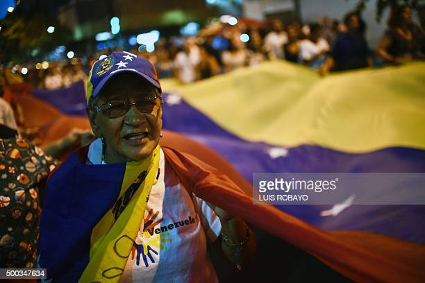 A Venezuelan opposition supporter celebrates the results of the legislative election in Caracas on December 7 2015 Venezuela's jubilant opposition...