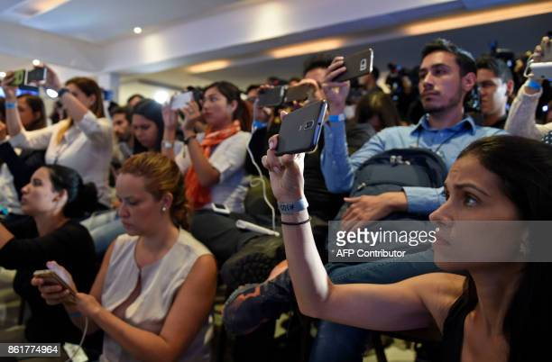Venezuelan opposition supporters and members of the media gather at the Democratic Unity Roundtable headquarters to wait for the results of the...