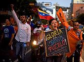 Venezuelan opposition supporters celebrate the results of the legislative election in Caracas on December 7 2015 Venezuela's jubilant opposition...