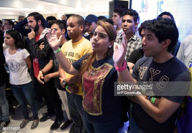 Venezuelan opposition supporters gather at the Democratic Unity Roundtable headquarters to wait for the results of the regional elections in Caracas...