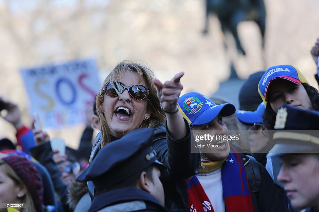 Venezuelan opposition supporters yell at counter-protesters in Union Square on February 22, 2014 in New York City. Opposition protests and a government crackdown in Venezuela have thown the country into turmoil in the last week.