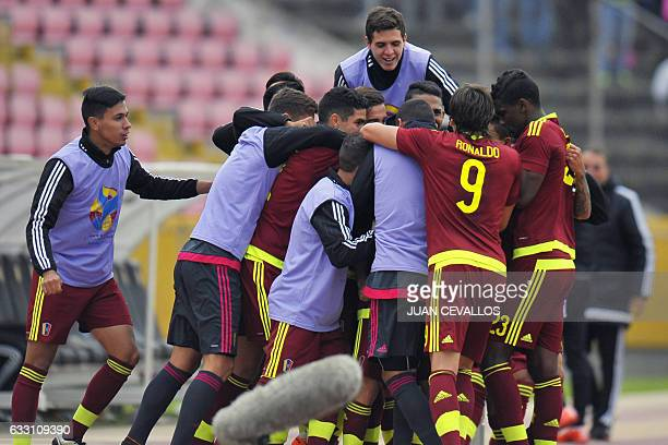 Venezuelan players celebrate after scoring against Colombia during their South American Championship U20 football match at the Olimpico Atahualpa...