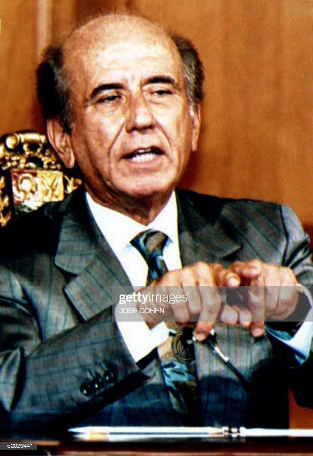 Venezuelan President Carlos Andres Perez speaks to the press 01 December 1992 during a press conference his first since the coup attempt 25 Nov Perez...