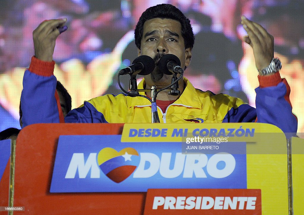 Venezuelan President elect Nicolas Maduro addresses supporters after knowing the election results in Caracas on April 14, 2013. Venezuela's acting President Nicolas Maduro declared victory on Sunday in the race to succeed late leader Hugo Chavez after the electoral council announced that he had won in a close battle. AFP PHOTO/Juan BARRETO