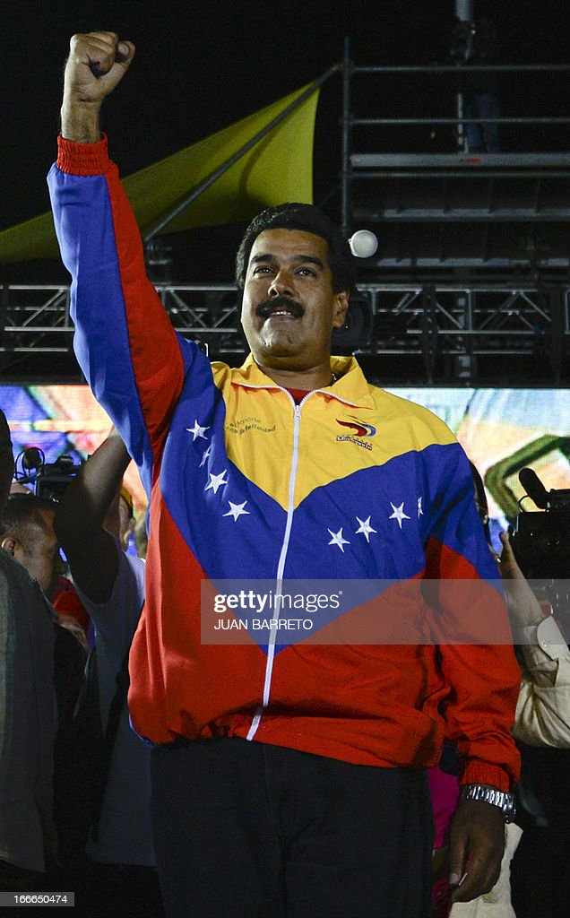 Venezuelan President elect Nicolas Maduro celebrates after knowing the election results in Caracas on April 14, 2013. Venezuela's acting President Nicolas Maduro declared victory on Sunday in the race to succeed late leader Hugo Chavez after the electoral council announced that he had won in a close battle. AFP PHOTO/Juan BARRETO