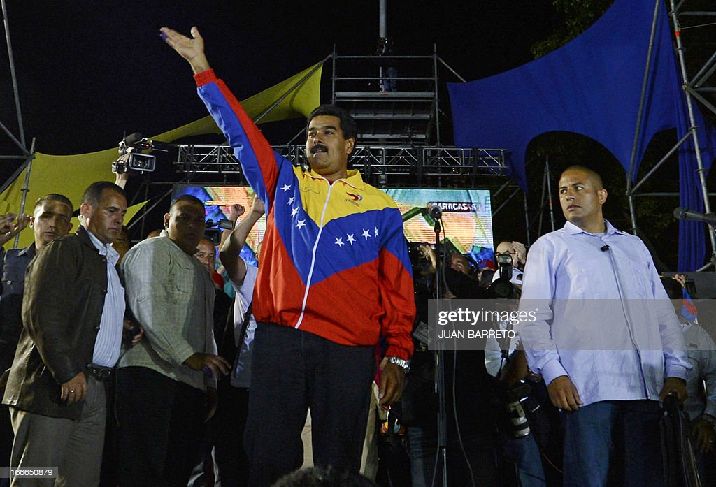 Venezuelan President elect Nicolas Maduro celebrates after knowing the election results in Caracas on April 14, 2013. Venezuela's acting President Nicolas Maduro declared victory on Sunday in the race to succeed late leader Hugo Chavez after the electoral council announced that he had won in a close battle. AFP PHOTO / Juan BARRETO