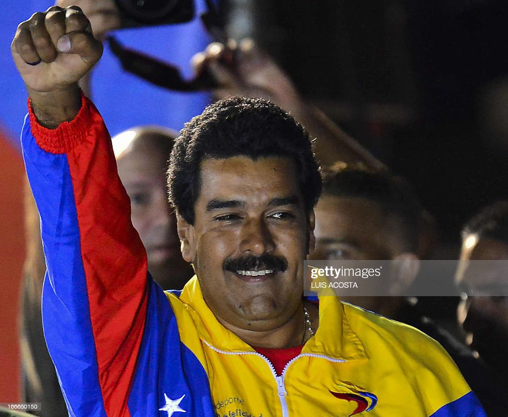 Venezuelan President elect Nicolas Maduro celebrates following the election results in Caracas on April 14, 2013. Fireworks erupted after the National Electoral Council announced that near complete results showed Maduro had won with just 50.66 percent of the vote compared to 49.1 percent for opposition rival Henrique Capriles -- a difference of less than 300,000 votes. AFP PHOTO/Luis Acosta