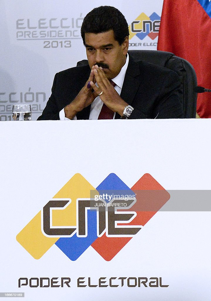Venezuelan President elect Nicolas Maduro waits to receive a document from the national electoral council, in Caracas on April 15, 2013. Venezuela's electoral authorities on Monday confirmed acting President Nicolas Maduro as the winner of the weekend election to succeed Hugo Chavez, despite opposition demands for a recount.