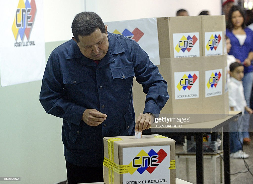Venezuelan President Hugo Chavez casts his vote in Caracas, on October 7, 2012, during presidential elections. Venezuelans voted Sunday with President Hugo Chavez's 14-year socialist revolution on the line as the leftist leader faced youthful rival Henrique Capriles in his toughest electoral challenge yet. AFP PHOTO/JUAN BARRETO