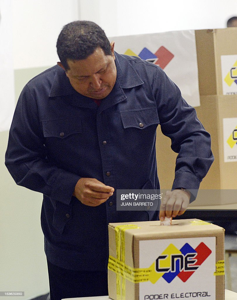 Venezuelan President Hugo Chavez casts his vote in Caracas, on October 7, 2012, during presidential elections. Venezuelans voted Sunday with President Hugo Chavez's 14-year socialist revolution on the line as the leftist leader faced youthful rival Henrique Capriles in his toughest electoral challenge yet.