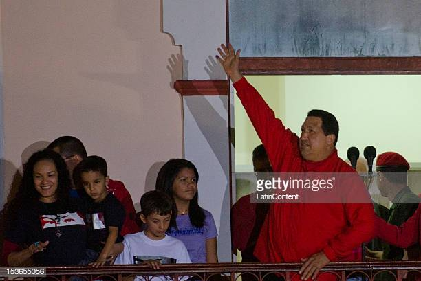 Venezuelan President Hugo Chavez celebrates after winning the presidential elections on October 07 2012 in Caracas Venezuela Chavez won with 5442%...