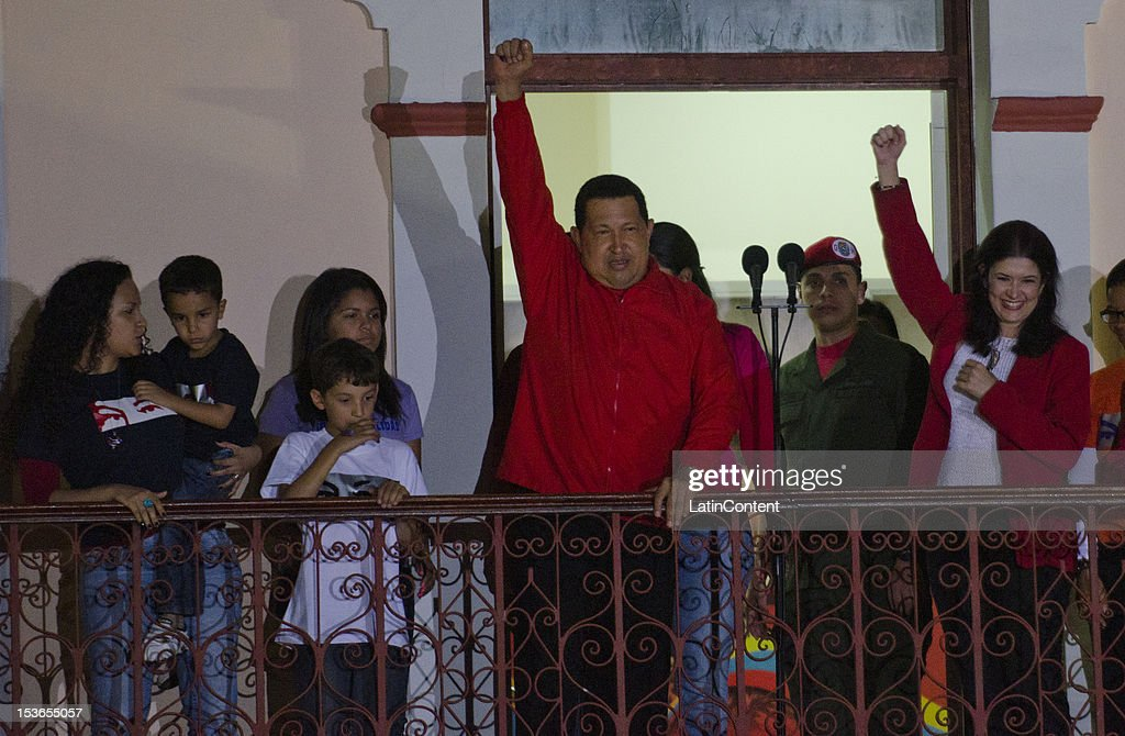 Venezuelan President <a gi-track='captionPersonalityLinkClicked' href=/galleries/search?phrase=Hugo+Chavez&family=editorial&specificpeople=171094 ng-click='$event.stopPropagation()'>Hugo Chavez</a> celebrates after winning the presidential elections on October 07, 2012 in Caracas, Venezuela. Chavez won with 54.42% (7,444,082 votes) while Henrique Capriles obtained 44.97% (6,150,544 votes). With these results the government will rule the next presidential term from 2013 to 2019.