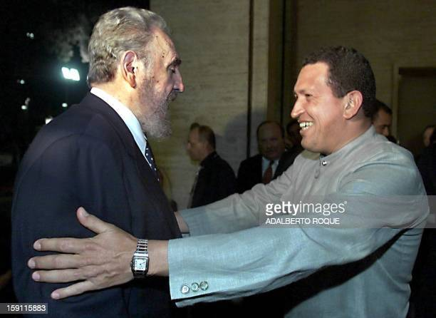 Venezuelan President Hugo Chavez embraces Cuban President Fidel Castro 29 June 1999 at a hotel in Rio de Janeiro on the sidelines of the Summit of...
