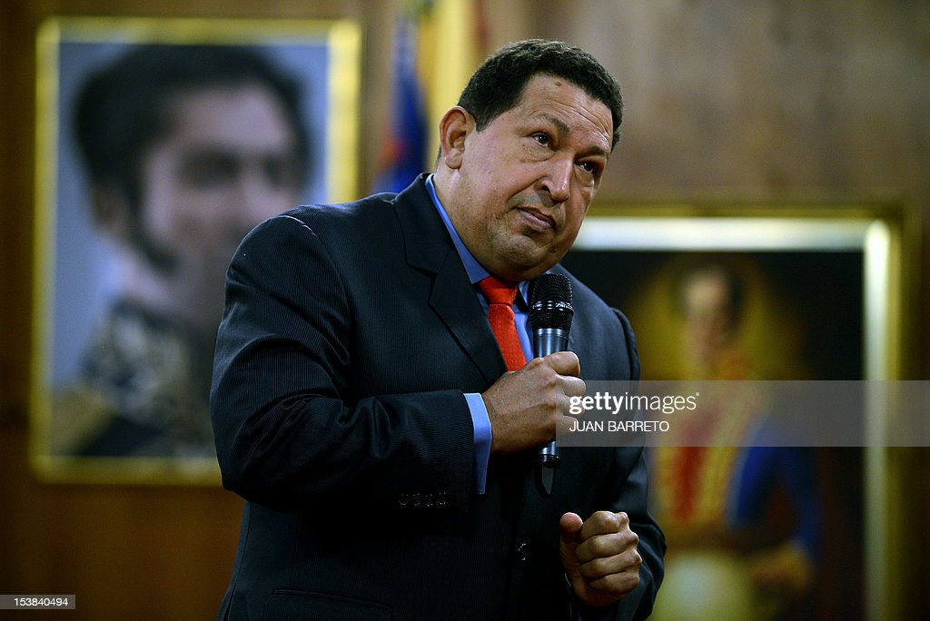 Venezuelan President Hugo Chavez gestures during a press conference in Caracas on October 9, 2012. Chavez pledged to become a 'better president' and work with the opposition after winning a tough re-election battle that betrayed simmering discontent at his socialist revolution. After almost 14 years in power, Chavez survived cancer and the most formidable opponent of his presidency, youthful business leader and former state governor Henrique Capriles, to win another six-year term.