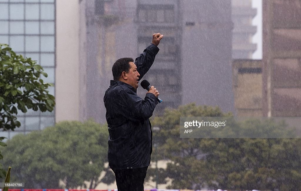 Venezuelan President Hugo Chavez gestures during his closing campaign rally in Caracas, Venezuela on October 4, 2012. The leftist leader, in power for almost 14 years, is vying for a fourth term in office that would extend his presidency for another six years, but opposition candidate Henrique Capriles hopes to pull a major upset on October 7 elections. AFP PHOTO/Luis Acosta