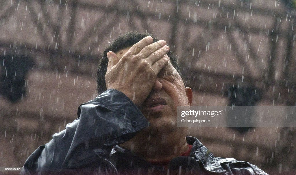 Venezuelan president Hugo Chavez gestures during the closing rally of his campaign at Bolívar avenue on October 04, 2012 in Caracas, Venezuela. Chavez will compete for the presidency with the opposition candidate Henrique Capriles in elections to be held next October 7.