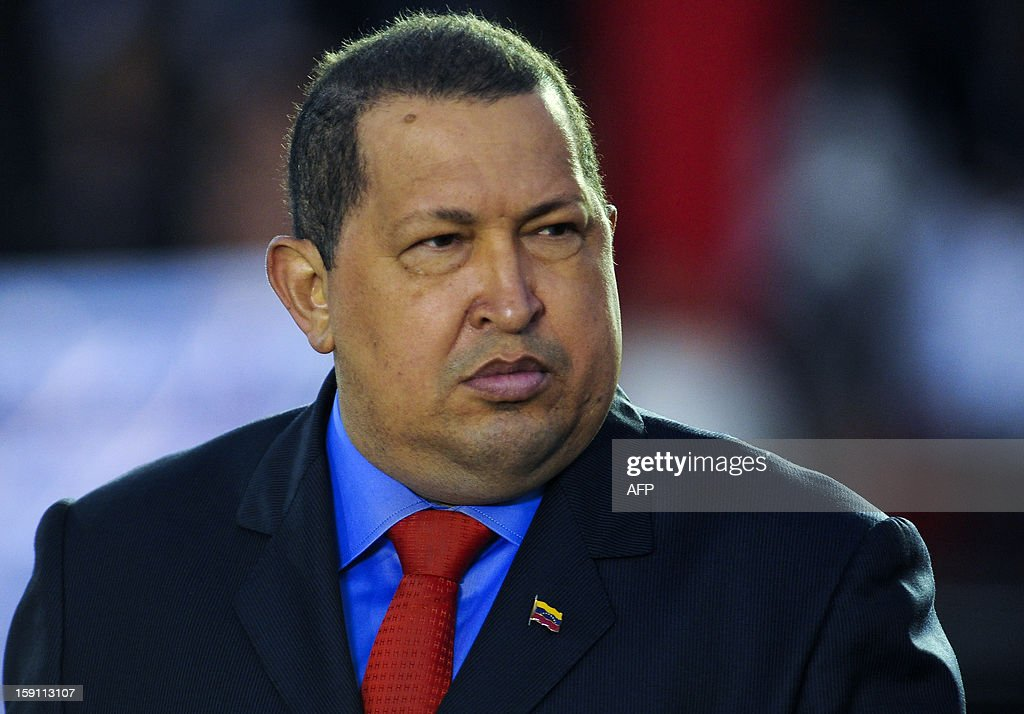 Venezuelan President <a gi-track='captionPersonalityLinkClicked' href=/galleries/search?phrase=Hugo+Chavez&family=editorial&specificpeople=171094 ng-click='$event.stopPropagation()'>Hugo Chavez</a> gestures during the military inauguration ceremony of his new Defense Minister Gen. Henry Rangel Silva (not in frame) on January 17, 2012 in Caracas. AFP PHOTO/Leo RAMIREZ