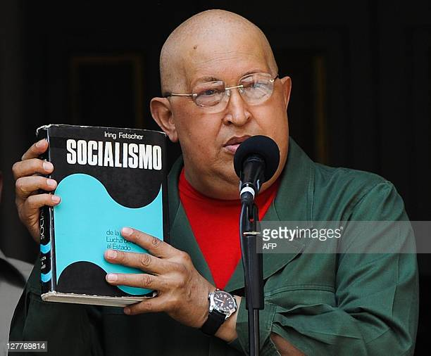 Venezuelan President Hugo Chavez holds a book entitled 'Socialism' during a speech at the Miraflor presidential palace in Caracas on October 1 2011...
