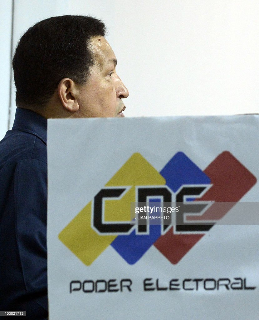 Venezuelan President Hugo Chavez is seen before casting his vote in Caracas, on October 7, 2012, during presidential elections. Venezuelans voted Sunday with President Hugo Chavez's 14-year socialist revolution on the line as the leftist leader faced youthful rival Henrique Capriles in his toughest electoral challenge yet.