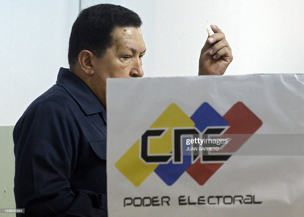 Venezuelan President Hugo Chavez prepares to cast his vote in Caracas, on October 7, 2012, during presidential elections. Venezuelans voted Sunday with President Hugo Chavez's 14-year socialist revolution on the line as the leftist leader faced youthful rival Henrique Capriles in his toughest electoral challenge yet.