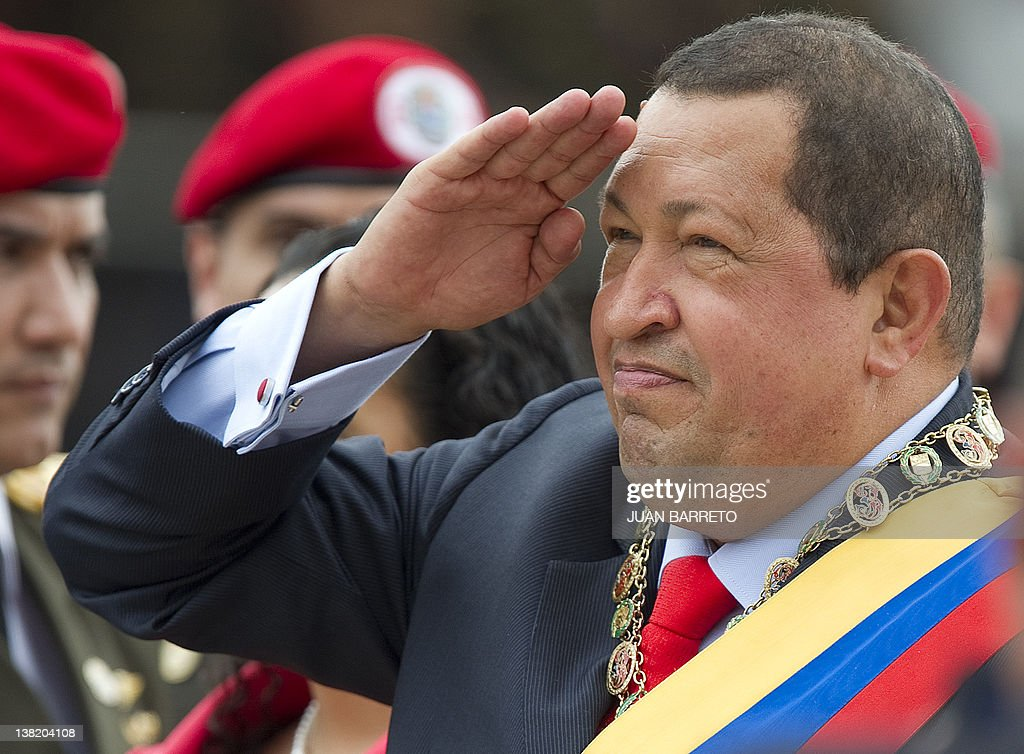 Venezuelan President <a gi-track='captionPersonalityLinkClicked' href=/galleries/search?phrase=Hugo+Chavez&family=editorial&specificpeople=171094 ng-click='$event.stopPropagation()'>Hugo Chavez</a> salutes during a military parade to commemorate the 20th anniversary of his failed coup attempt, on February 4, 2012, in Caracas. AFP PHOTO/JUAN BARRETO