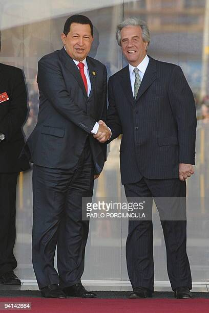 Venezuelan president Hugo Chavez shakes hands with his Uruguayan counterpart upon arrival at the presidential meeting of the Mercosur Summit in...