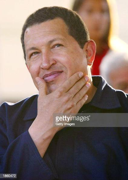 Venezuelan President Hugo Chavez smiles during a ceremony handing out land titles to low income households March 20 2003 in Caracas Venezuela Chavez...
