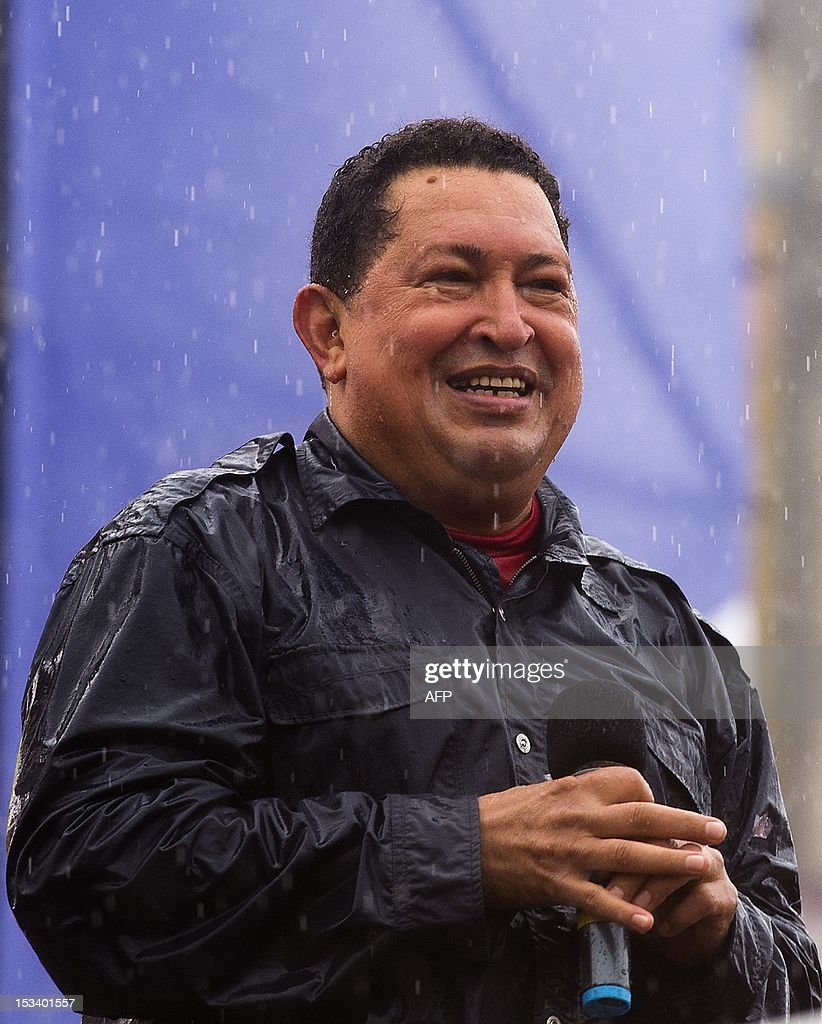 Venezuelan President Hugo Chavez smiles during his closing campaign rally in Caracas, Venezuela on October 4, 2012. The leftist leader, in power for almost 14 years, is vying for a fourth term in office that would extend his presidency for another six years, but opposition candidate Henrique Capriles hopes to pull a major upset on October 7 elections. AFP PHOTO/Luis Acosta