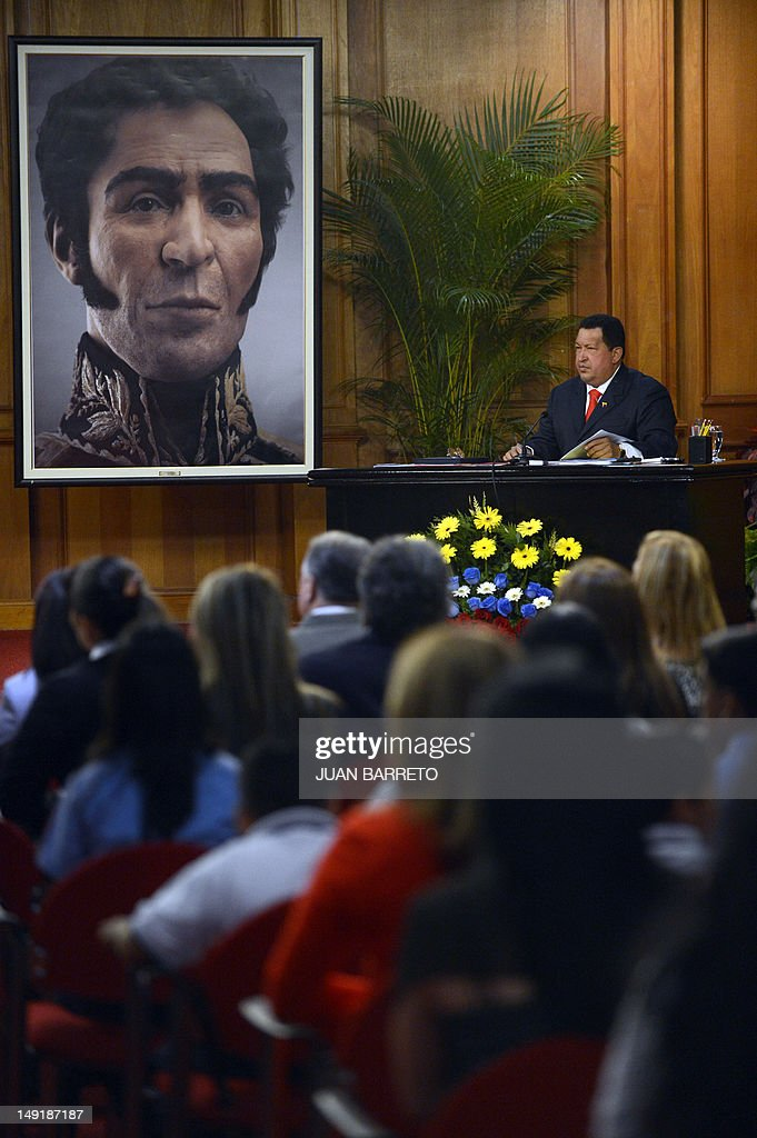 Venezuelan President Hugo Chavez (R) speaks after unveiling a picture showing the possible face of Liberator Simon Bolivar --a digital rendering from genetic data, following the exumation of Bolivar remains in 2010-- during celebrations of Bolivar's brithday in Caracas on July 24, 2012.