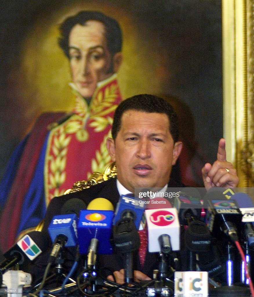 Venezuelan President Hugo Chavez speaks during a news conference at Miraflores Presidential Palace April 15, 2002 in Caracas, Venezuela. Chavez was ousted and arrested April 12, 2002 by his military high command but returned after a collapsed coup along with a loyalist troops rebellion and protests.