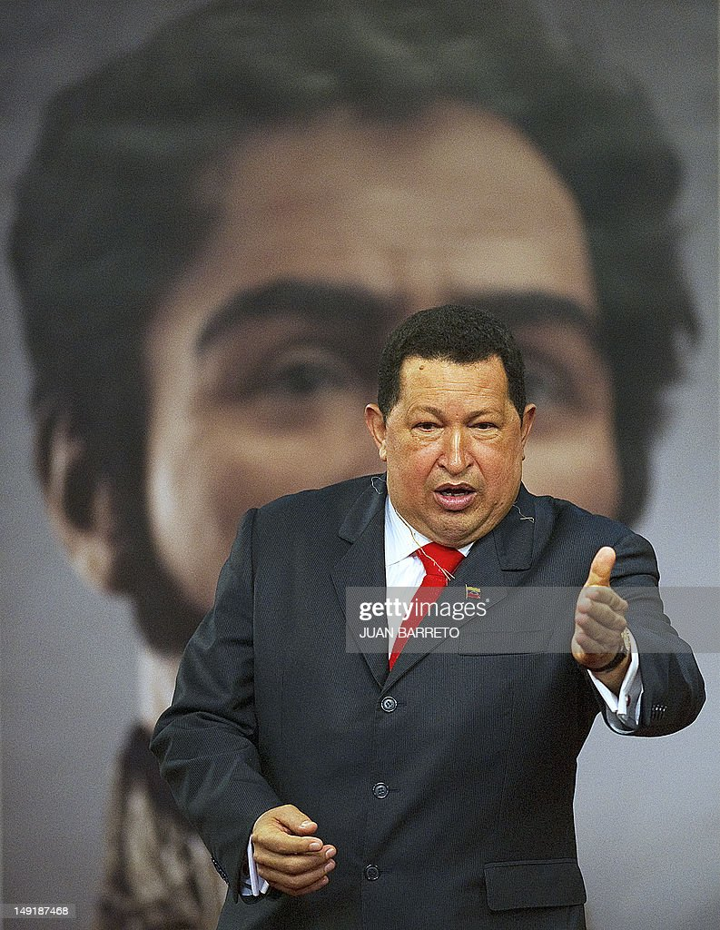 Venezuelan President Hugo Chavez speaks in front of a picture showing the possible face of Liberator Simon Bolivar --a digital rendering from genetic data, following the exumation of Bolivar´s remains in 2010-- during celebrations of Bolivar's brithday in Caracas on July 24, 2012.