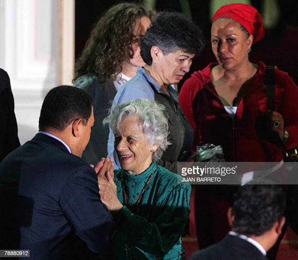 Venezuelan president Hugo Chavez talks to Clara Gonzalez de Rojas mother of Colombian politician Clara Rojas at the presidential palace in Caracas la...
