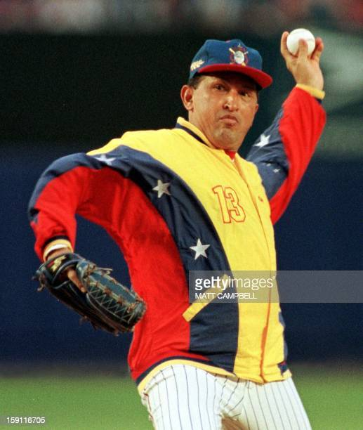 Venezuelan President Hugo Chavez throws out the ceremonial first pitch 09 June 1999 before the New York Mets game against the Toronto Blue Jays at...