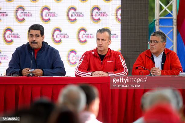 Venezuelan President Nicolas Maduro accompanied by Vice President Tareck El Aissami and Education Minister Elias Jaua delivers a speech during the...