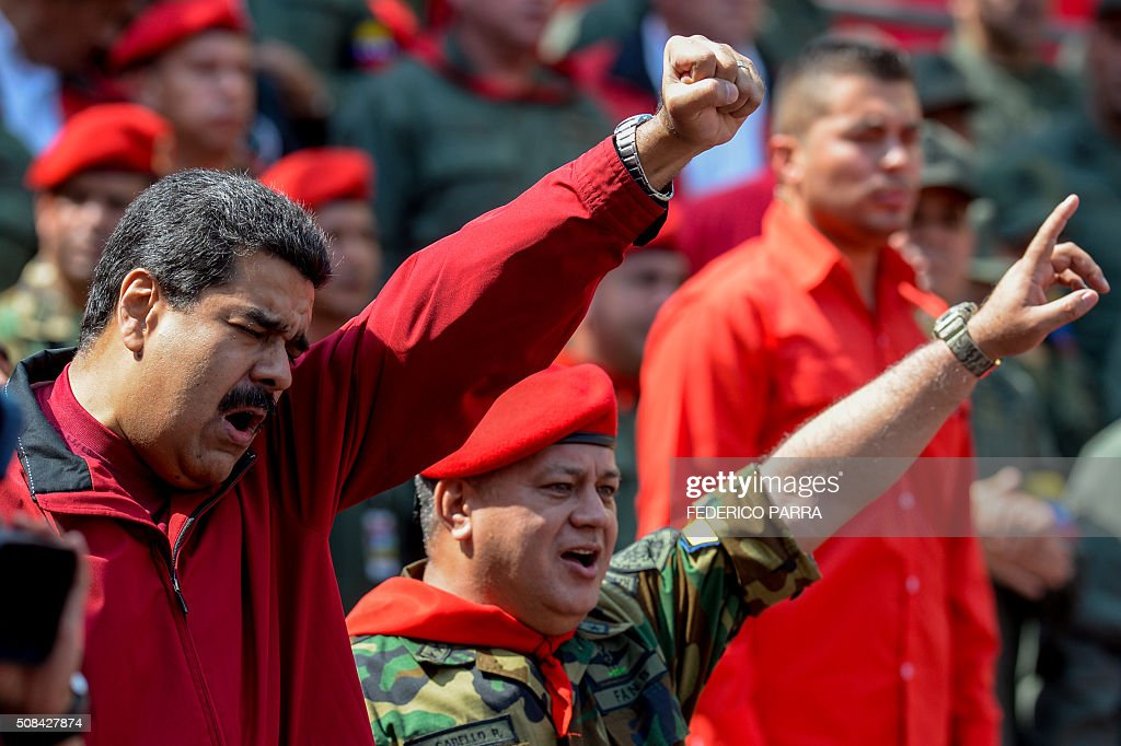 Venezuelan President Nicolas Maduro and deputy and former president of the National Assembly Diosdado Cabello salute during a ceremony to commemorate...