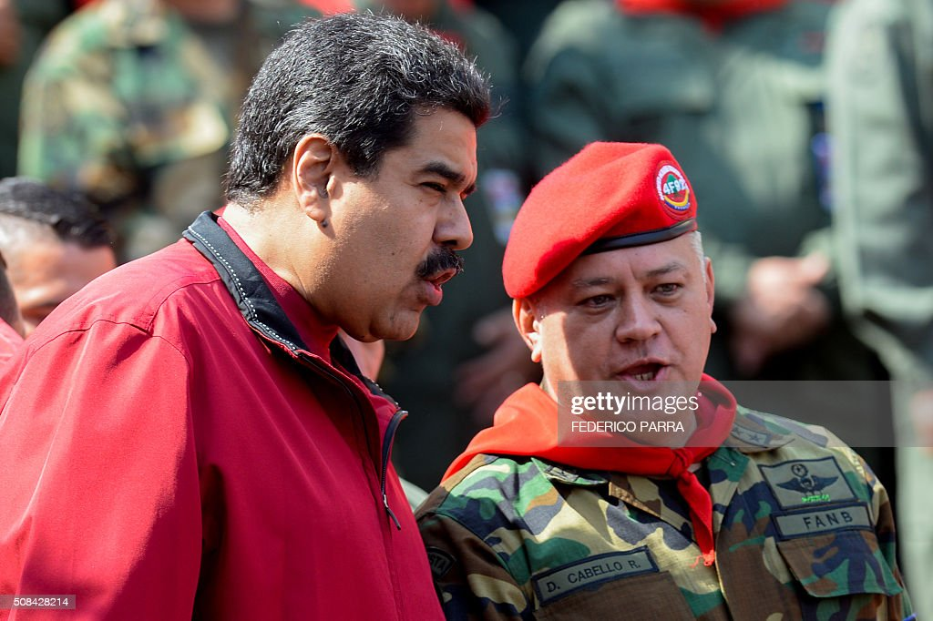 Venezuelan President Nicolas Maduro and deputy and former president of the National Assembly Diosdado Cabello chat during a ceremony to commemorate...