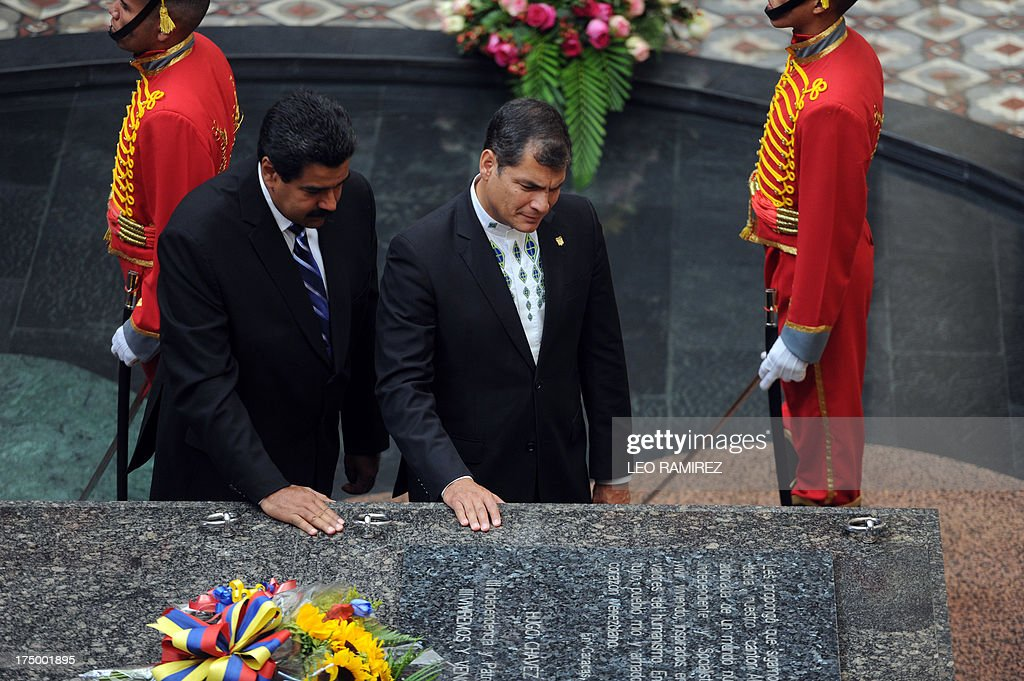Venezuelan President Nicolas Maduro (L) and Ecuadorean President Rafael Correa pay tribute at the tomb of the late president Hugo Chavez, on July 29, 2013 at the Cuartel de la Montana, Caracas. Correa visits Venezuela to strengthen bilateral cooperation projects with Nicolas Maduro's government, five months ago Hugo Chavez's death. AFP PHOTO/Leo RAMIREZ