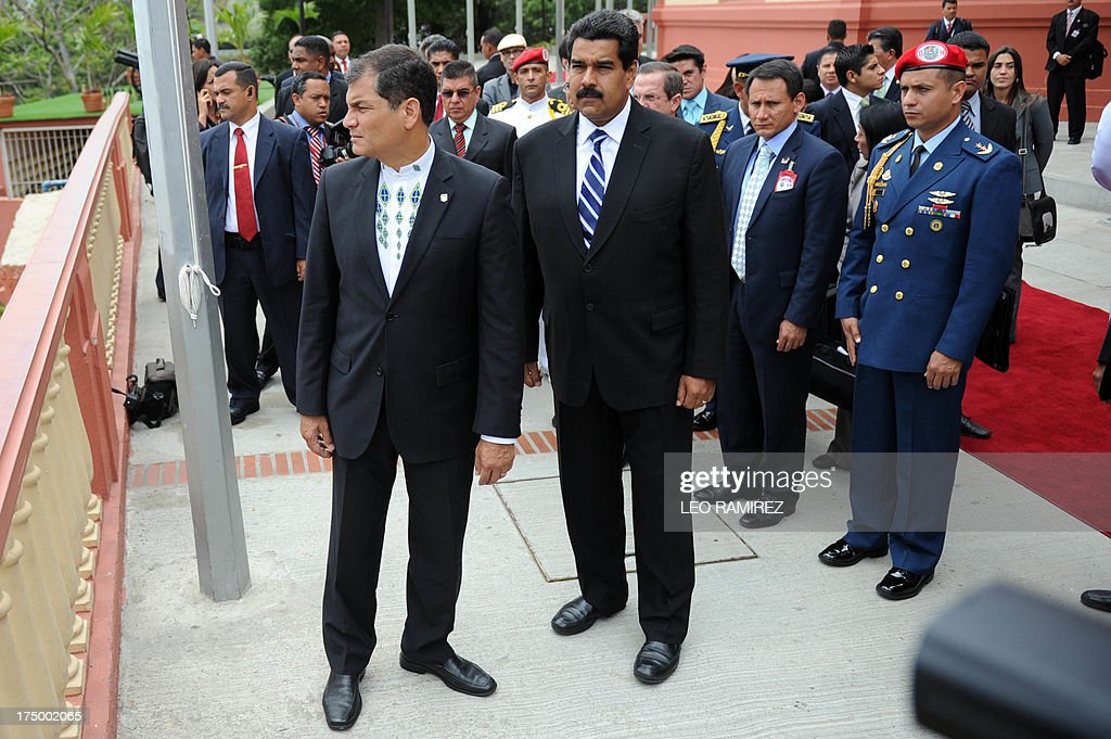 Venezuelan President Nicolas Maduro (L) and Ecuadorean President Rafael Correa arrive at the Cuartel de la Montana to pay tribute to late president Hugo Chavez, on July 29, 2013 in Caracas. Correa visits Venezuela to strengthen bilateral cooperation projects with Nicolas Maduro's government, five months ago Hugo Chavez's death. AFP PHOTO/Leo RAMIREZ